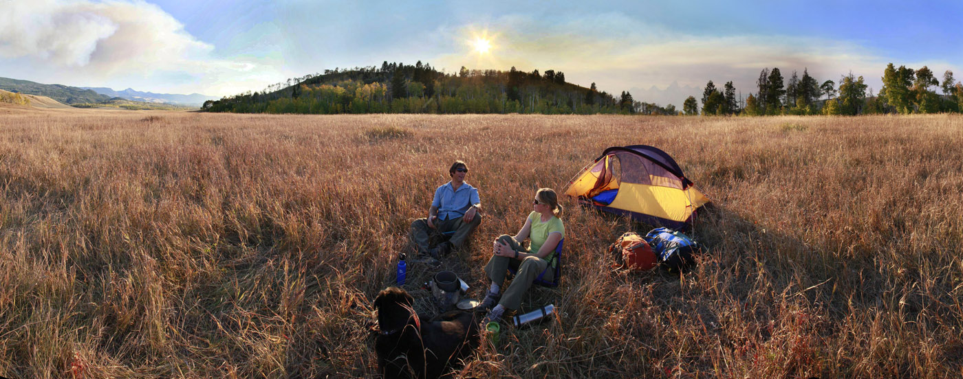 camping,lifestyle,outdoors,Jackson,WY,Wyoming,tenting,backlit,scenic,panorama,dog,happy,couple,sunny,field,grasses,autum, photo