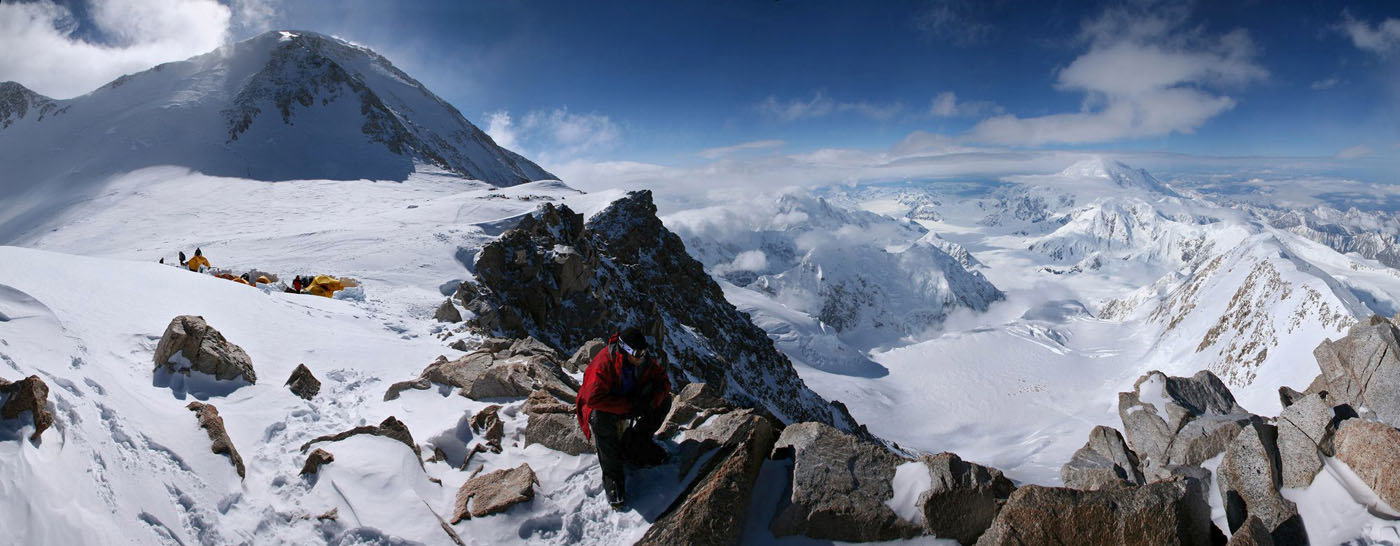 A mountaineer looks down 1000 meters to the 14,200ft camp on Denali, from High Camp at 17,200 above the West Buttress. The summit...